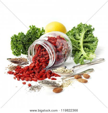 Various superfoods on white background. Healthy food, diet, vegetarian or clean eating concept.