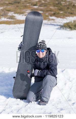 Portrait Of Smiling Man With Snowboard
