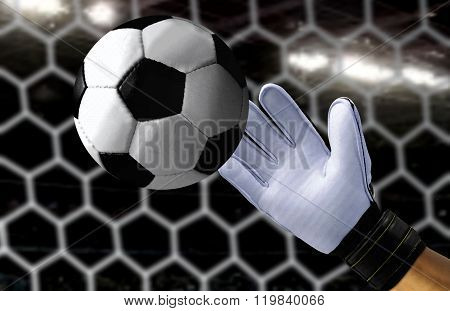 Goal Keeper Trying To Catch A Fast Soccer Ball