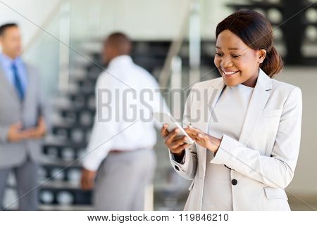 beautiful young african american career woman using cell phone