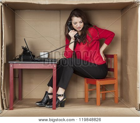 Business Woman Sitting In The Office And Talking On The Phone