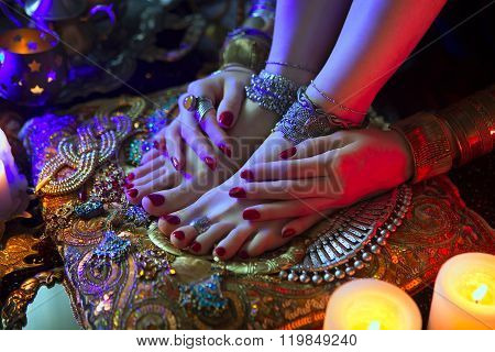 Indian Wedding Preparation. Luxury Oriental Fashion Accessories: Female foot and Hands Beautiful National Indian Bridal Golden Jewellery. Eastern Traditional Sari clothes. Color lenses Candlelight poster