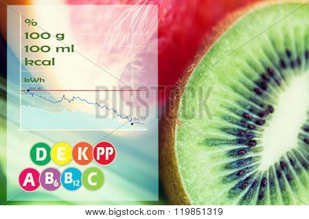 diet, food, healthy eating and objects concept - close up of ripe kiwi and grapefruit slices with calories and vitamins chart