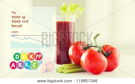 healthy eating, organic food and diet concept - close up of fresh tomato juice glass and vegetables on table with calories and vitamin chart
