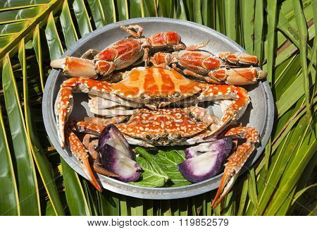 Dish with cooked crabs