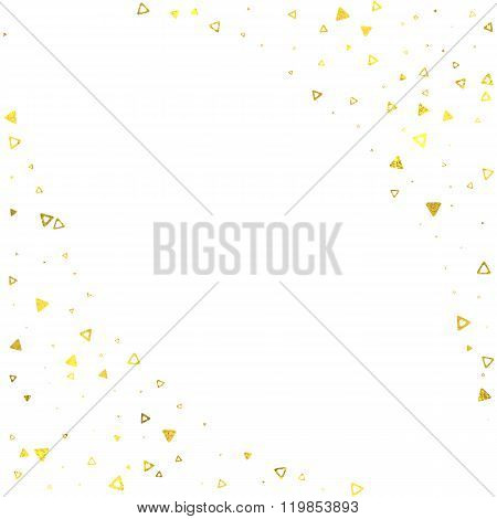 Gold glittering foil triangles on white background