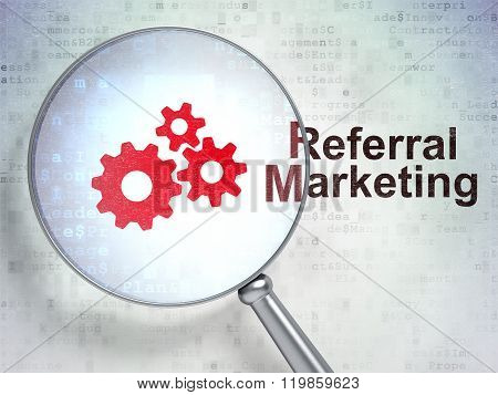 Marketing concept: Gears and Referral Marketing with optical glass