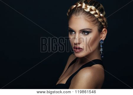 Beauty Portrait Of A Young Woman With Braid Hairstyle