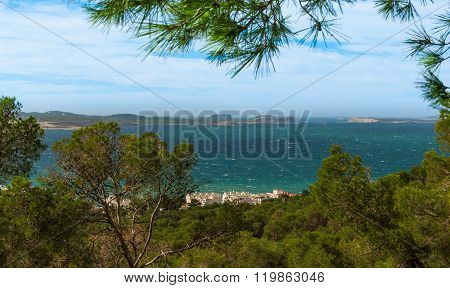 Hill side view from St Antoni de Portmany, Ibiza, into balearic sea on a clearing day in November, f
