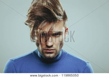 Handsome Man With Modern Hairstyle In Studio