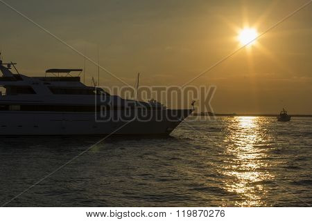 seascape view of a large motor yacht at sunset in  Dubai