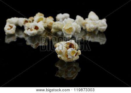 Popcorn With Reflection On Black Background