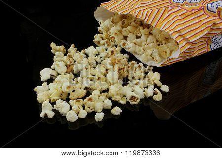 Popcorn Bag Dumped On Black Background
