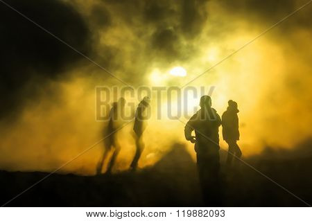 People Walking Through Steam