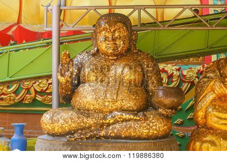 Golden statue of Budha in the Budhist Temple in Thailand.