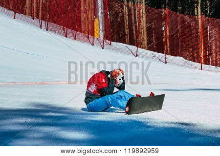 girl athlete snowboarder disappointment after a failed attempt