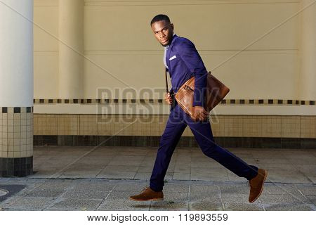 Young Businessman Running On City Street