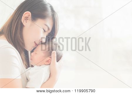 Happy Mother Holding Adorable Child Baby Boy
