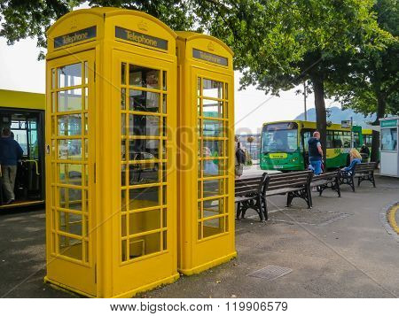Old Yellow Phone Booths On The Street Of Saint Peter Port