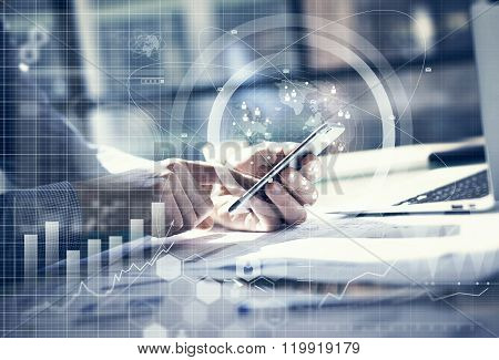 Business concept. Businessman working generic design laptop. Touching screen smartphone. Worldwide c