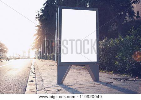 Photo empty lightbox on the bus stop. Horizontal mockup, sunlight