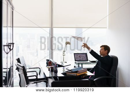 Successful Man Office Worker Daydreaming Throwing Paper Airplane