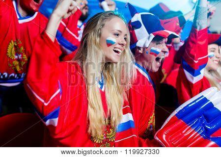 Young spectators in uniform in stadium poster