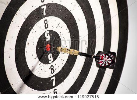 Dart In The Bulls Eye Center Of A Dart Board
