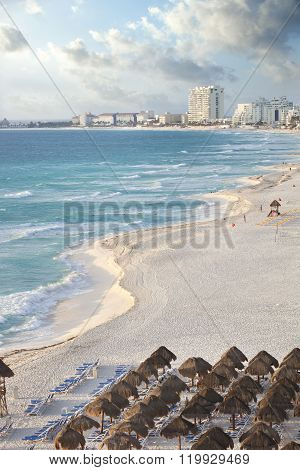 Brilliant Blue Sea And Curving Beach In Cancun, Mexico