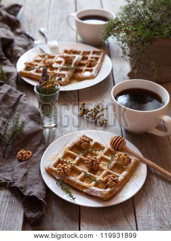 Belgian waffles sweet healthy dessert with honey, nuts, coffee, herbs.