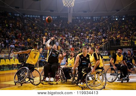 Unidentified People Play A Friendly Game Of Wheelchair Basketball At Nick Galis Stadium