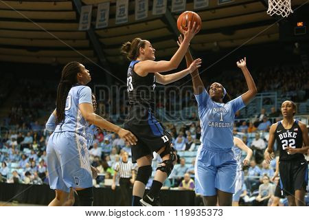 CHAPEL HILL, NC-FEB 28: Duke Blue Devils guard Rebecca Greenwell (23) drives to the basket as UNC Tar Heels forward Rachel McGirt (1) defends on February 28, 2016 at Carmichael Arena.