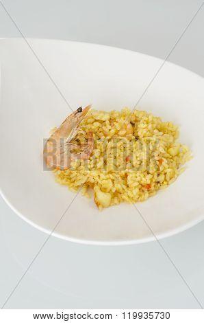 Paella, Typical Spanish Dish On White Background.