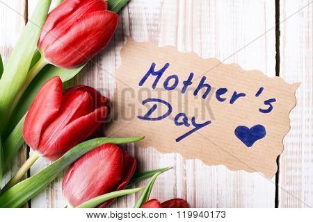 Mother's Day card and a bouquet of beautiful tulips