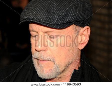 The famous actor Bruce Willis walking in the streets of Manhattan