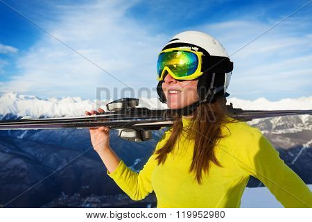 Happy skier woman on sunny day