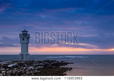 Beacon On An Ocean Coast During A Sunset. Iceland