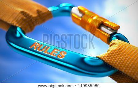 Rules on Blue Carabiner between Orange Ropes.