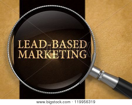 Lead-Based Marketing through Loupe on Old Paper.