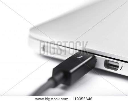 LONDON,UK-JAN.01: thunderbolt cable on an hard disk photographed on 18th january 2013 in LondonUK. Intel thunderbolt is a new connectivity solution that offer a speed of transfer faster 10 times compared to esata and older connection solution.