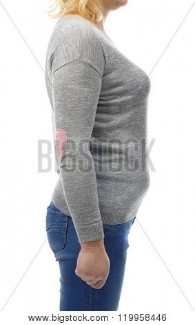 Chubby woman's body in gray tee-shirt and jeans isolated on white