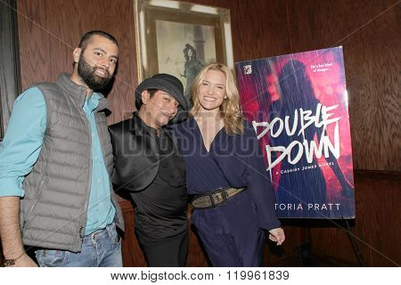 Khoder Osman, Andre Soriano and Victoria Pratt at the book signing of Pratt's new book,