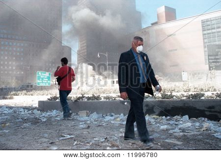 NEW YORK - SEPTEMBER 11:  Pedestrians walk near the area known as Ground Zero after the collapse of the Twin Towers September 11, 2001 in New York City.