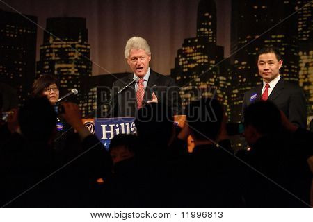FLUSHING, NY - MARCH 27: Former US President Bill Clinton (C) stumps for his wife, Hillary, as NYC Councilman John Liu (R) listens at Korea Village Banquet Hall on March 27, 2007 in Flushing, NY.