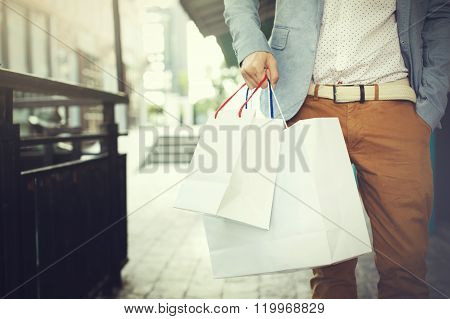 Shopaholic Man Walking On Commercial Street With A Lot Of Shopping Bags