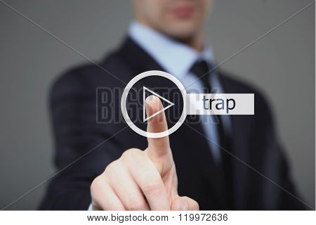 Businessman pressing play trap music button