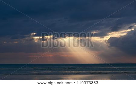 The rays of the sun on the sea in the clouds