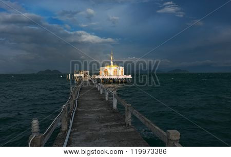 Pier leading to the pagoda on the beach