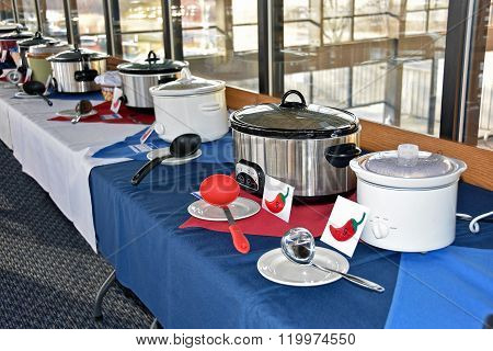 row of crock pots for chili cook off