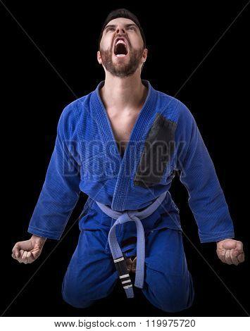 Judoka fighter isolated on black background